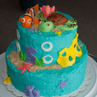 "Finding Nemo Cake My first tiered cake! The bottom tier is chocolate and the top is ""yellow"". The cake is covered in buttercream frosting and the..."