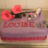 Cake Whit Roses And Shoe A small cake for my daughter in law.Chocolate cake, and hazelnut cake, bisquiscakeFill light ganasche mixed with daim and a mousse of...