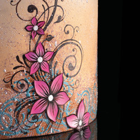 Cocoa Butter Painting. Colored cocoa butter layering and texture. Airbrush base and splatter. Hand painted vines and flowers. Flowers are edible printer paper...