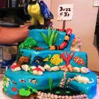 Pet Shop Cake This cake was made for the Aquarium & Pet Shop where my husband works for their summer picnic. It incorporates something from every...