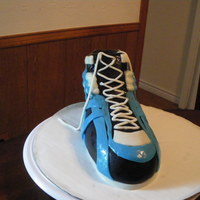 Shoe Cake a shoe shaped cake for a dear friend!.. it didnt come out half as nice as i hoped it to..but he was kind enough to say he liked it.. have...