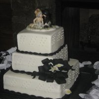 Black Ropes And Bows!   3 tier, square cake, buttercream icing, fondant rope and callas and bow.