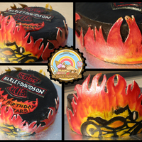 Harley Davidson This is a cake I made for a Harley Davidson Fan...The flames were painted on fondant cutouts. Homemade Fondant. Wilton Gel colors. TFL