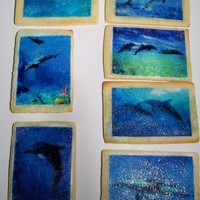 Dolphin Cookies Created in honor of my elderly friend Ann, who loved dolphins and the sea, for the reception following her memorial services. The edible...