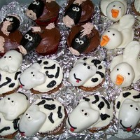 Farm Animal Cupcakes 3 of 6 different kinds of farm animal cupcakes created for a child's birthday party. These are the horses, cows, and ducks.