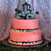 Sweet Sixteen In Pink & Black This is a vanilla cake with White Chocolate Cream Cheese Butter Cream. Two tiers.