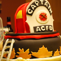 Firefighter Cake I did this cake for an Atlantic City Fire Fighter who is retiring. I replicated his helmet. I'm very happy with the helmet, but not so...