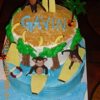1St Birthday Monkey Cake Surfing monkeys 1st birthday. Monkeys are made from modeling chocolate and surf boards, life preserver, beach balls, and bananas are all...