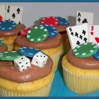 Gambling Lovers Cupcakes! These were made for my mother....who enjoys all types of gambling! Chocolate, strawberry cheesecake cupcake (grahm bottom, strawberry...