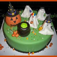 "Halloween Birthday 14"" chocolate cake with chocolate whipped buttercream filling. Covered in fondant. Cauldron and pumpkin are rice krispie treats. All..."