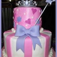 "Princess 5"" and 9"" french vanilla cake with strawberry filling. Covered in buttercream with fondant decorations. Wand and tiara made from..."