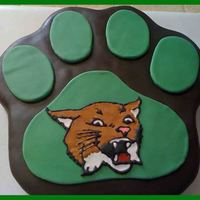 "Bobcats!! This was made for a girl's volleyball banquet at our local school. Carved from a 12"" round chocolate cake. Filled with chocolate..."