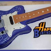 "Hannah Montana Guitar Base of guitar is sculpted from a 12"" chocolate square cake, and the neck is sculpted from a 9""x13"" french vanilla cake. All..."
