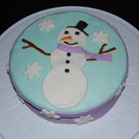 Snowman Cake  I still haven't had any cake decorating classes, although I'm starting them this week!I made this cake to raffle off at a bake...