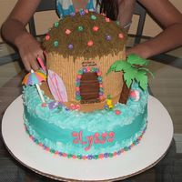"Alyssa's Surf Shack  This is a 10"" round covered in buttercream, with (3) 6"" rounds for the tiki hut. I let one of the 6"" dome on top to get the..."