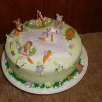Easter Cake 2010 French Vanilla cake with French vanilla butter cream and all fondant/gumpaste decorations. I had so much fun making every little detail of...