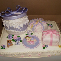 Baby Shower Gifts  Baby shower cake with fondant covered gifts and fondant/gumpaste accessories and flowers. The hat box was chocolate andes mint cake and...