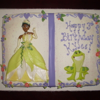 Princess And The Frog  Princess and the Frog story book. Buttercream frosted, scroll work and writing (sorry so messy looking, one of my meds was making me shake...