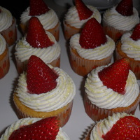 Strawberry Lemonade In A Cupcake!  Lemon Cupcake filled with Fresh Strawberry filling, topped with Lemon Buttercream and a strawberry! These were so refreshing on a hot...