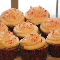 Candy-Cane Cupcakes! A vanilla sponge cake with crushed candycanes folded into the batter. Vanilla-bean buttercream, with more crushed candy