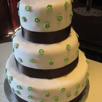 Green Flowers A 12,9,6 wedding cake with fondant cutout flowers :)