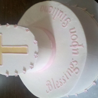 Baptism Baby Girl Round bottom cake with oval cake on top. Oval is bevelled to better show the cross.