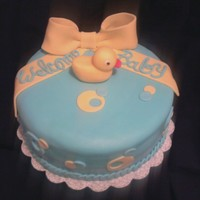 Welcome Baby Cake W/ Ducky 8inch round cake covered in fondant. Bow made w/ half gumpaste/fondant. Ducky made out of fondant. TFL