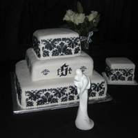Damask Stencil Square Wedding Cake My FIRST wedding, tier, & stenciling cake!Three tiers: 8in, 12in, 16in. Side 6in square cake. Covered in buttercream fondant with black...