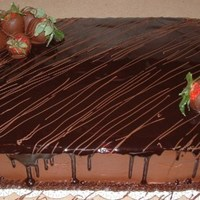 Chocolate Cake Chocolate cake with a strawberry filling and fudge sauce, topped with chocolate covered strawberries.