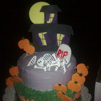 Halloween 5 layer alternating chocolate and french vanilla cake sandwiched with almond buttercream, covered with fondant, all decorations are fondant...