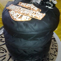 Motorcycle Tires These are 3 8-inches cakes, trimmed and wrapped in black fondant to resemble motorcycle tires. Harley Davidson logo is royal icing. My...
