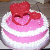 Valentine's Cake For Mom  This is a cake I made my mom for Valentine's Day. It's a white cake with cookies & cream filling & the icing is BC. The...