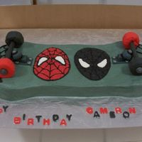 Spiderman Skateboard  The ends of the board are chocolate cake & the middle is white cake & the whole thing is iced in BC. The wheels are rice krispie...