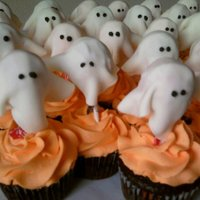 Boo! cupcakes that I made for my daughter's preschool Halloween party. The ghosts are fondant covered tootsie pops.