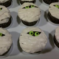 Mummy Cupcakes made for my daughter's preschool. I saw them on wilton.com