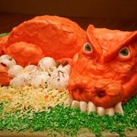 Dinosaur/dragon Cake   this is a cake i made for a little girl's 3rd birthday. She loves dinosaur mommies with lots of grrr to them...