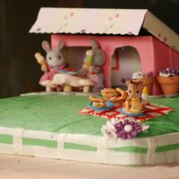 Calico Critters Cake  I cake I did for a little girl. She loves the Calico Critter figurines. I made all the teeny tiny food, blankets, picnic baskets, tableware...