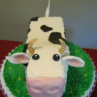 Cow! Carrot cake with cream cheese frosting, choco-pan/mm fondant details. For a farm-themed birthday party for a two-year old. Inspired by...