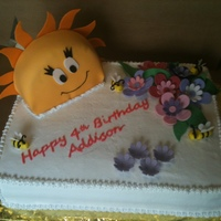 Sunburst inspired by a cake sold at a wholesale retailer. details are fondant. sun is a 6in. round