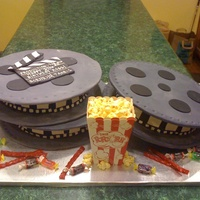 "Movie Reel  This cake was for my daughter's boss who is a movie fanatic. He said the cake gave him ideas for decorating his ""theater room&..."