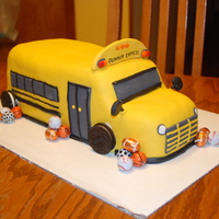 School Bus   I made this cake for a guy I work with for his 2 yr old son. The cake is half white and half chocolate.