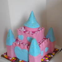 Princess Castle Cake 2 This was a second request I had for a Princess castle. Chocolate cake covered in fondant. The 'pebbles' were actually...
