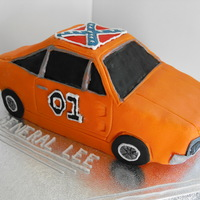 The General Lee This was for an avid fan of the Dukes of Hazzard. Chocolate cake carved into a car - any mans dream!?! Hmmmmm