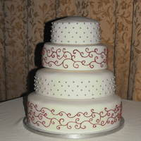 Red Velvet And Sponge Wedding Cake This was a four tier wedding cake i did for my friends wedding. The twot iers with the silver balls on were made from red velvet and the...