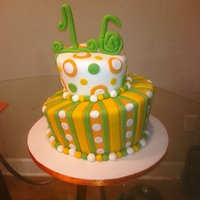Sweet 16 Topsy Turvy Cake This cake was made for a girl who was turning 'Sweet 16.' Her colors were bright yellow, green and orange. I had some free range...