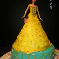 Beauty And The Beast Strawberry Cake with cheesecake frosting for Bell and Chocolate with chocolate for the base cake.