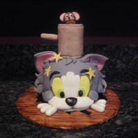 ~Tom And Jerry~  Jerry is knocking Tom through the floor! Tom is seeing stars!!! I made everything by hand! Tom is all cake! :) (I got the idea from Debbie...
