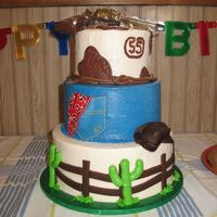 "Cowboy Cake  6"", 8"", & 10"" round cakes iced in buttercream with fondant accents and chocolate gun topper. Thank you to sugarshack for..."