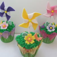 Pinwheels, Flowers And Butterflies, Oh My!  For a babies 1st BD. My friend asked for May/Spring theme cupcakes. So I thought it would be cute to do pinwheels and flowers made out of...