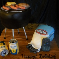 Bbq Grillin & Beers Cake Prepared as customer requested. Used chocolate cake, rice cereal, marshmallows, and edible images to complete design.
